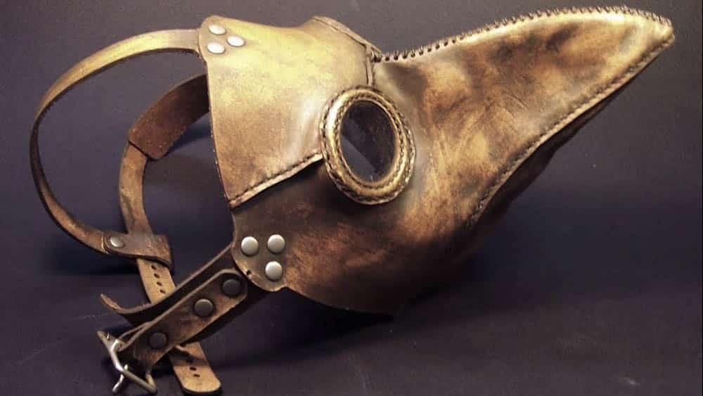 Máscara com bico usada por médicos no século XIV para evitar infecções como a da peste bubônica